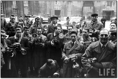 Press Photographers crowd around Dwight D. Eisenhower, 1951
