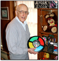 Ralph Baer holds a Simon toy in his basement, May 2012
