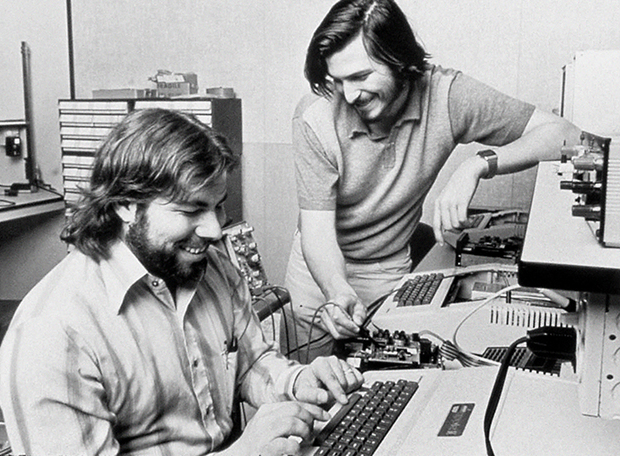 Steve Wozniak and Steve Jobs with an Apple II