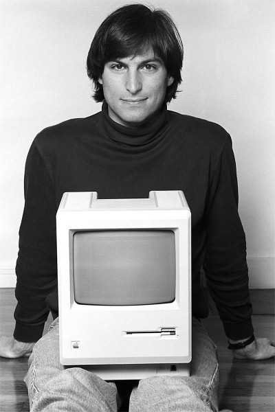 Steve Jobs with a Macintosh